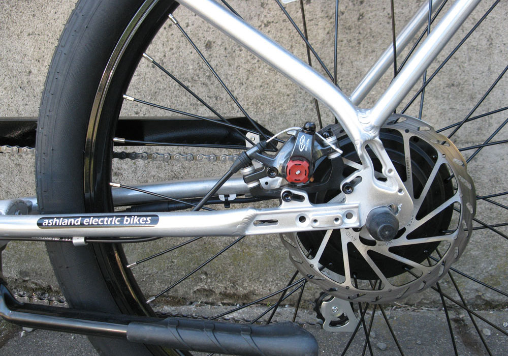 Pedego Interceptor Classic silver electric bike motor and disc brake close up