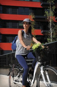 Verticle woman on bike