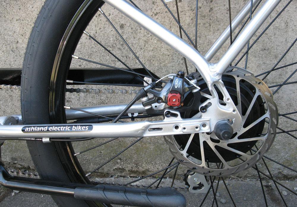 Pedego Interceptor Classic silver electric bike motor and disc brake close up